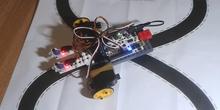 Prueba de siguelíneas con Arduino y piezas LEGO. Programado con Ardublock en MAX