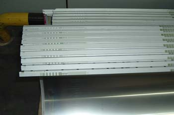Pliegue de sujeción de planchas offset