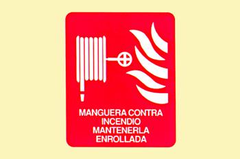 Incendio: manguera contra incendios enrrollada