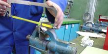 Operación de Aserrado de metales