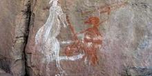 Pintura rupestre: escena de caza, Kakadu, Australia