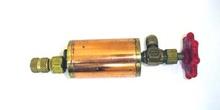 Inyector para aditivos de equipo de aire acondicionado