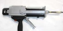 Pistola de aplicación de adhesivos bicomponentes