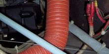 Conducto de aire caliente al carburador