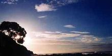 Playa y puesta de sol en Northwind Lodge, Nueva Zelanda