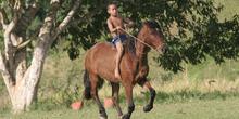 Niño montando a caballo, Quilombo, Sao Paulo, Brasil