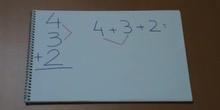 Suma de tres números