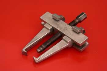 Extractor universal de dos garras