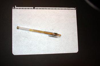 Cuartilla y bolígrafo