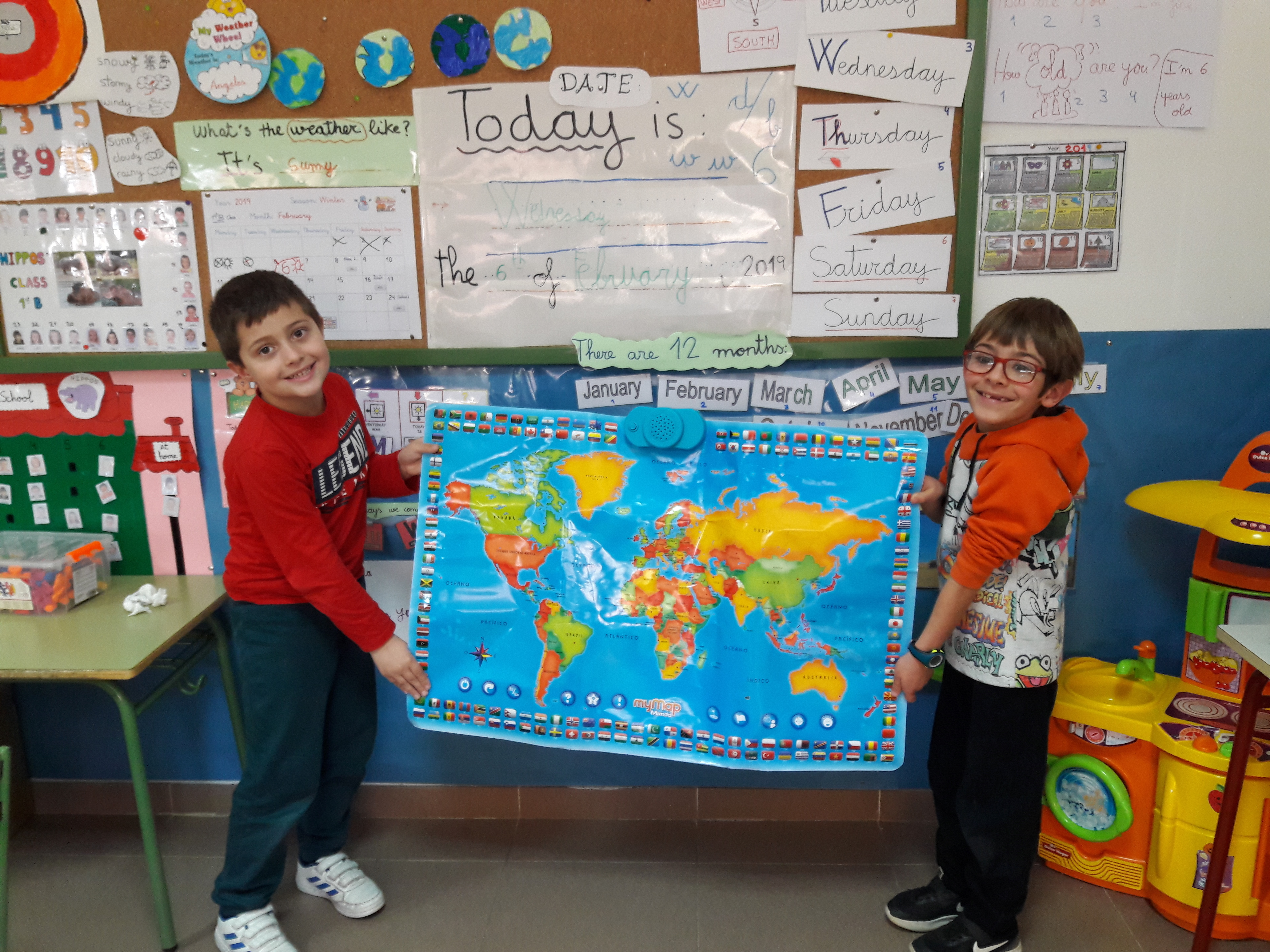 Mario and Luca-Matei are holding the World map